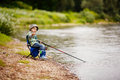 Photo of little boy fishing Royalty Free Stock Photo