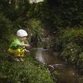Photo of little boy fishing cute on river Stock Photo