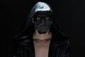 Photo of the madman in handmade mask on black background Royalty Free Stock Image