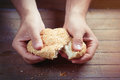 Photo of male hand touching fresh bun with sesame on the wonderf Royalty Free Stock Photo
