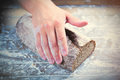 Photo of male hands touching fresh cut bread on the wonderful br Royalty Free Stock Photo