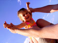 Photo man holding up child doing airplane pose Royalty Free Stock Photo