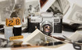 Photo memories old film camera with bunch of old black white photographs on white background with wooden cubes showing date Royalty Free Stock Photos
