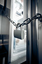 Photo of metal lock hanging on refrigerator door closeup Stock Photo