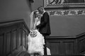 Photo of newly married couple hugging on stairs at palace black and white Stock Photography
