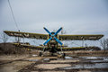 Photo of an old airplane on airfield and cloudy background Royalty Free Stock Photo