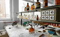 Photo of an old laboratory with a lot of bottles and dirt Stock Photos