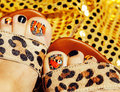 Photo of pedicure like butterfly design on gold background close up, mani pedi creative concept