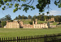 A photo of the ruins of port arthur in tazmania with a fence and tree Stock Photography