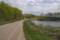 photo of rural road with lake. Royalty Free Stock Photo