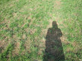 Photo of shadow of girl on grassy meadow Royalty Free Stock Photo
