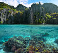 Photo of sharp cliffs and colorful coral reefs in the Philippine Royalty Free Stock Photo