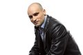 Photo sitting hairless man in leather jacket Royalty Free Stock Photo