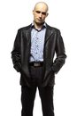 Photo of standing hairless man in leather jacket Royalty Free Stock Photo