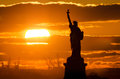 Photo statue liberty sunset fire made brooklyn new york city Stock Photo
