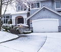 Photo suburban home snow drive way lawn plants trees roof Royalty Free Stock Images