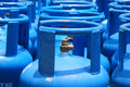 Photo taken some blue painted portable gas cylinders tank canisters Royalty Free Stock Image