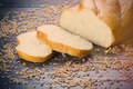 Photo of tasty fresh bread loaf on the wonderful brown wooden ba Royalty Free Stock Photo