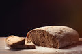 Photo of tasty fresh loaf of bread on the wonderful brown wooden Royalty Free Stock Photo