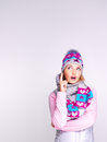 Photo of a thinking girl in winter clothes looking up studio Royalty Free Stock Image
