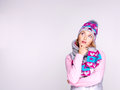 Photo of a thinking girl in winter clothes looking up studio Royalty Free Stock Photography