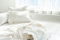 Photo of untidy bed against window Royalty Free Stock Photo