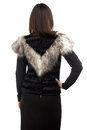 Photo woman in black fur waistcoat from the back of on white background Stock Images