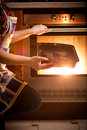 Photo of woman cooking chocolate cookies in oven closeup Royalty Free Stock Photo