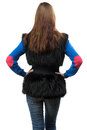 Photo of woman in fake fur waistcoat from the back young on white background Stock Photography