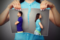 Photo of young couple in quarrel woman lacerating over dark background Royalty Free Stock Photos
