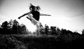 Photo of young girl jumping high on field black and white Stock Images