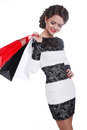 Photo of young joyful woman with shopping bags  isolated on whit Stock Image