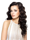 Photo of young woman with beauty long hair curly fashion model posing at studio Royalty Free Stock Photo