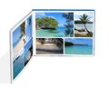 Photobook with photos of beach scenes isolated on white Stock Images