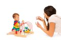 Photograph baby playing mother her little toddler boy with puzzle developing toy with camera on cell phone Royalty Free Stock Images