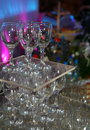 A photograph of an empty transparent colorless glass wine glasses set by the pyramid to decorate the buffet table on Royalty Free Stock Photography