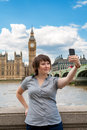 Photograph of herself london uk young woman taking a photo in front the westminster england Stock Image