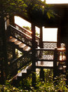 Title: Thai traditional timber house details in sunlight