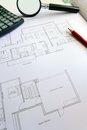Photograph showing still life picture some new condominium apartment floor plans taken magnifying glass calculator pencil Royalty Free Stock Images