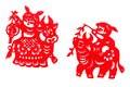 A photograph showing two festive papercuttings a traditional ethnic form of art and craft in china depict children riding on cows Royalty Free Stock Images