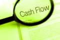 A photograph of some fine printed financial documents with the large words cash flow in focus Stock Photography