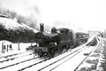 Steam train in snow A Royalty Free Stock Photo