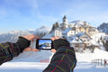 Photographed with cell phone photographing a winter landscape idyllic village monte lussari italy Stock Photos