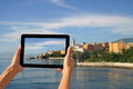 Photographed with tablet girl taking pictures on a in bastia corsica france Royalty Free Stock Images