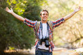 Photographer arms open mountain young in valley Royalty Free Stock Photos