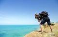 The photographer on breakage photographs sea Stock Image
