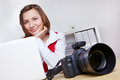 Photographer with camera and laptop Royalty Free Stock Photo