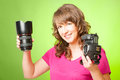 Photographer with camera and lens female holding dslr digital lense Royalty Free Stock Images