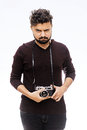 Photographer. Close up portrait of guy holding vintage camera