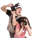 Photographer couple with digital camera. Royalty Free Stock Photo